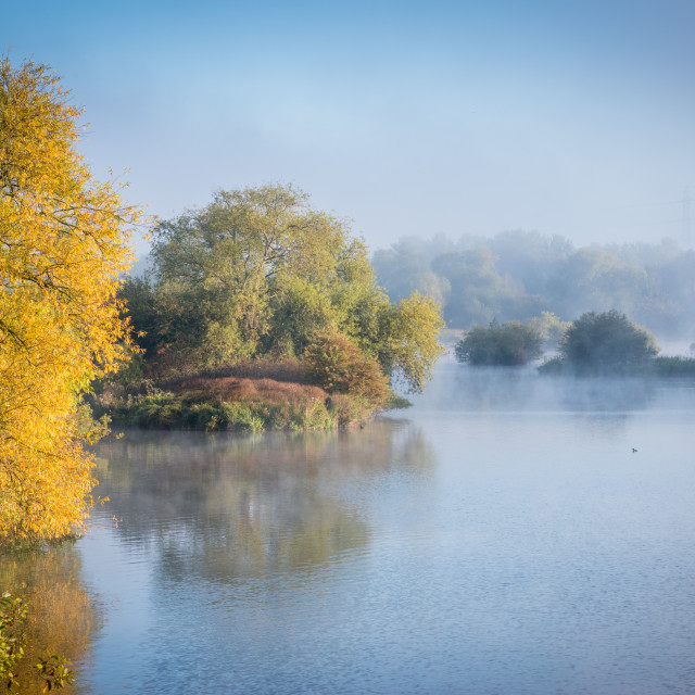 """A misty morning at Hooksmarsh lake in the Lee Valley Country Park, Essex"" stock image"