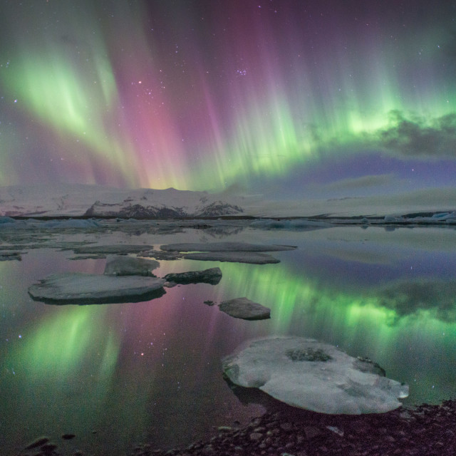 """The Northern lights viewed over Jokulsarlon glacier lake in Iceland"" stock image"