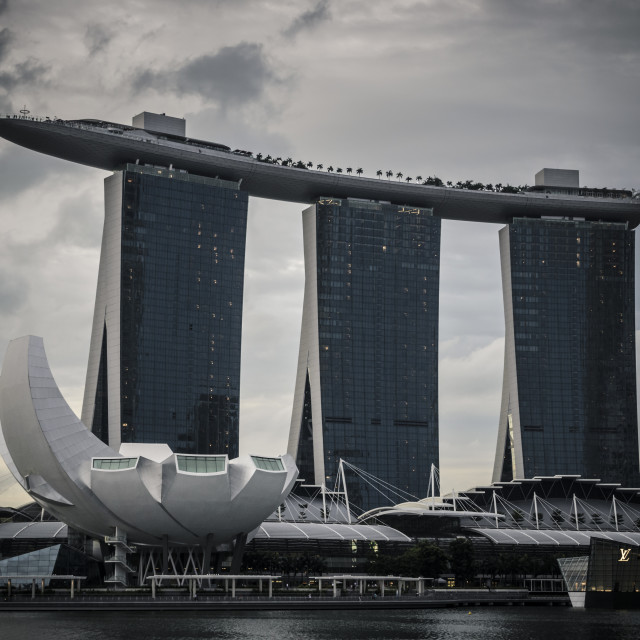 """Dark clouds over the Marina Bay Sands and the ArtScience Museum"" stock image"