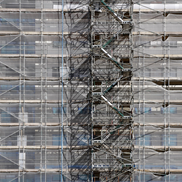 """""""Scaffolding on a high rise building for renovations"""" stock image"""