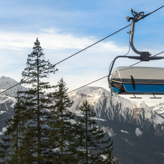 """Ski chairlift and Alps mountains peaks"" stock image"