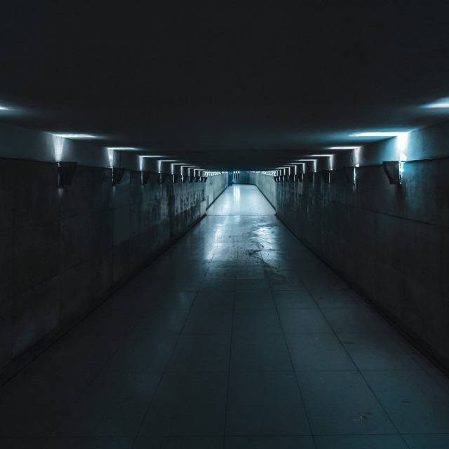 """Underground passage with blue light"" stock image"