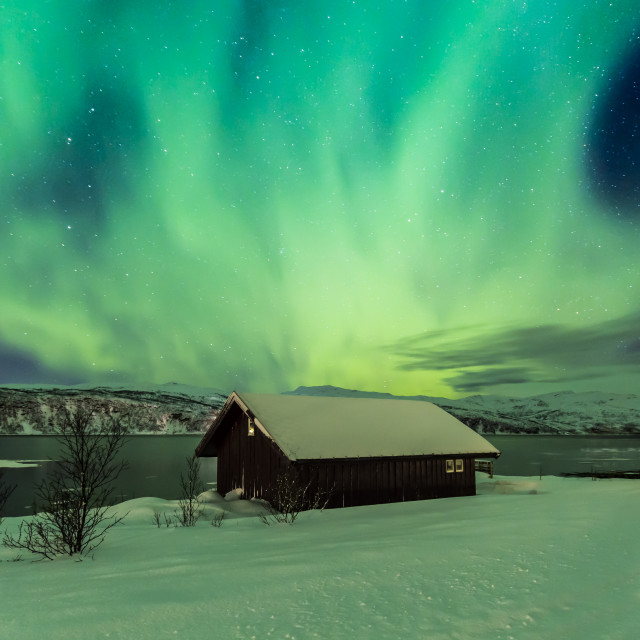 """Northern lights Aurora Borealis in the night above a typically artic style..."" stock image"