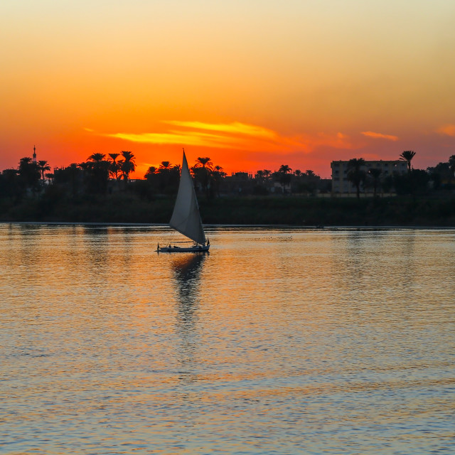 """Sunset on the Nile River with Felucca boat sailing, Luxor, Egypt"" stock image"