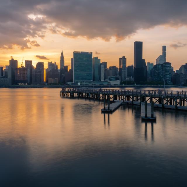 """Manhattan skyline with Gantry Plaza State Park pier at sunset"" stock image"
