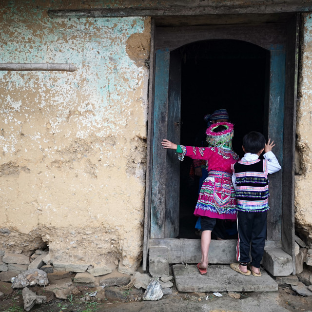 """Black Hmong Children standing in the door."" stock image"