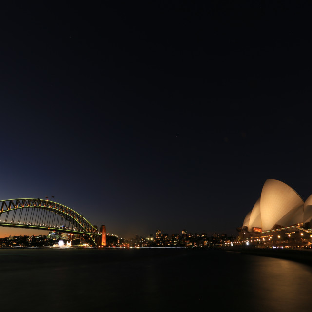 """iconic of sydney , the opera house and harbour bridge on slow shutter"" stock image"