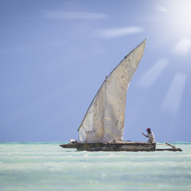 """Dhow fishing boat sailing on the Indian ocean"" stock image"