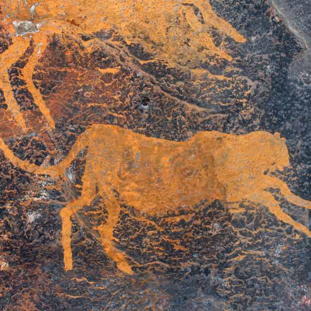 """Rock painting of a cheetah"" stock image"