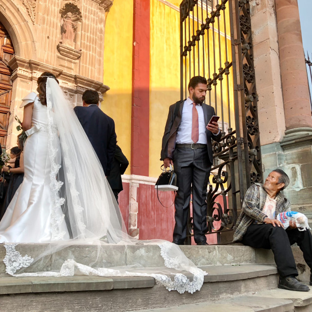"""A Wedding and the Street Seller"" stock image"