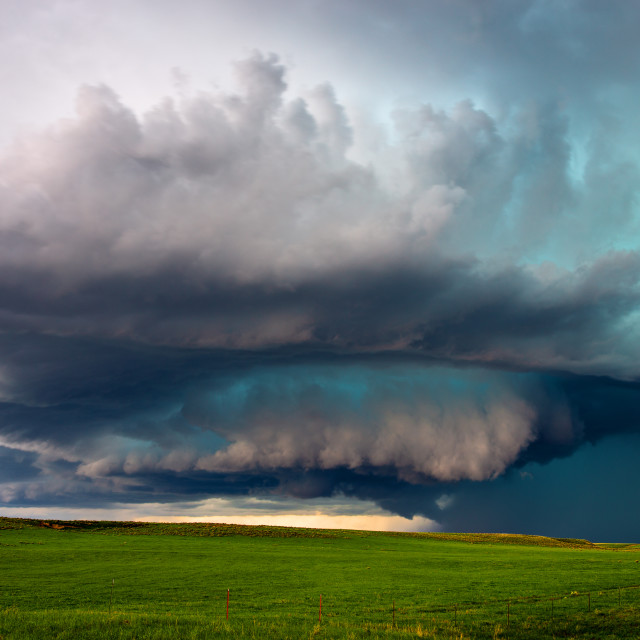 """""""Supercell thunderstorm over a field."""" stock image"""