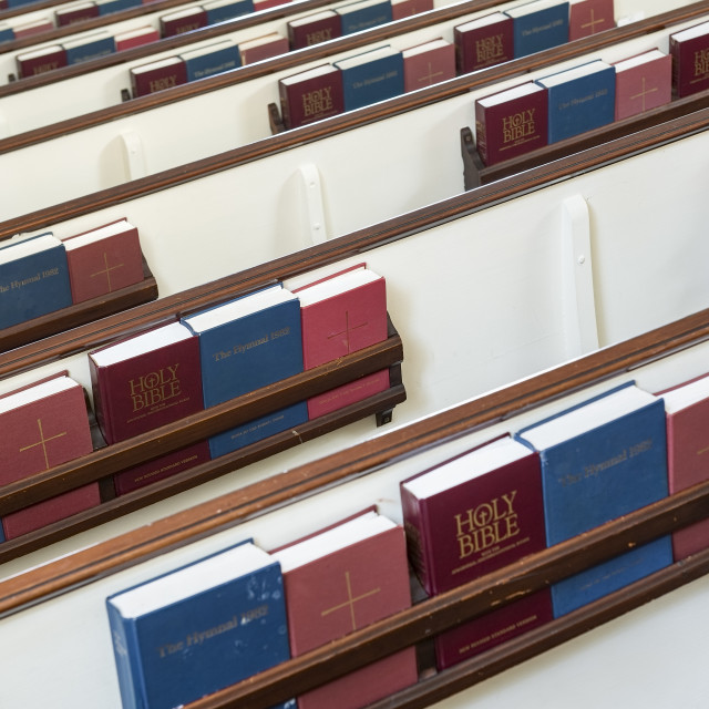 """""""Church pews with prayerbooks and hymnals"""" stock image"""