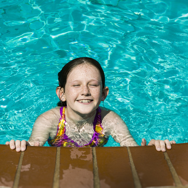 """""""Candid portrait of a girl swimming."""" stock image"""