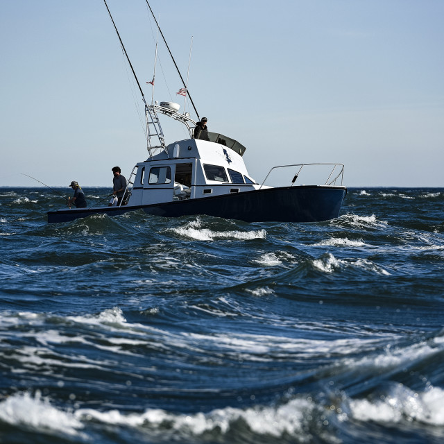 """""""Charter fishing boat on rough sea"""" stock image"""
