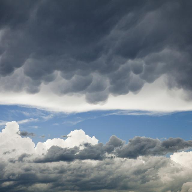 """Mammatus and Cumulus Clouds"" stock image"
