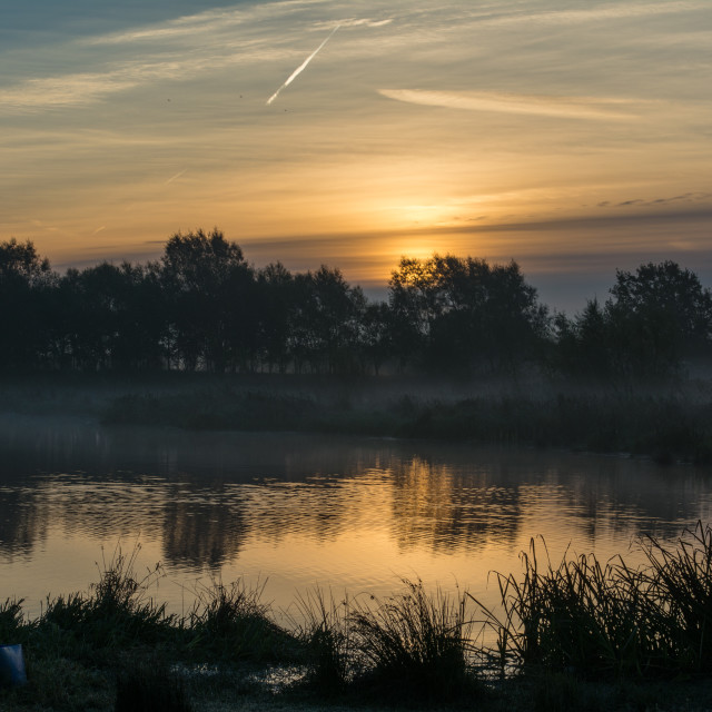 """Sunrise at Manby lake"" stock image"