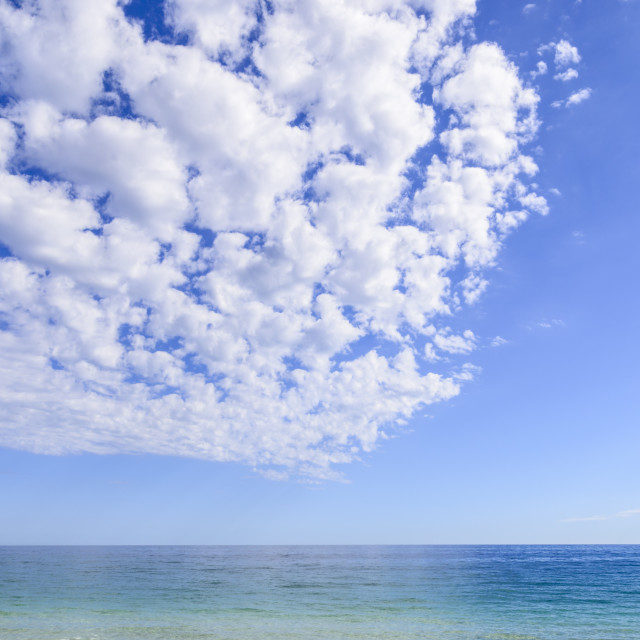 """Clouds in a big blue sky"" stock image"