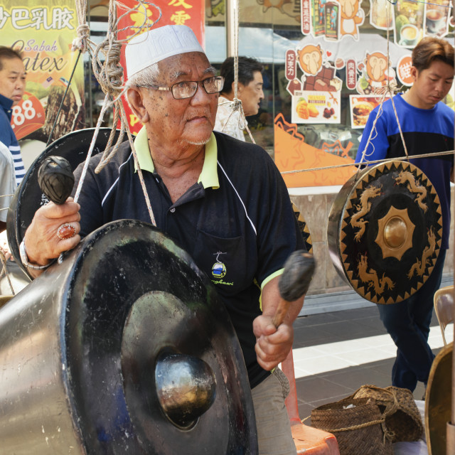 """""""The gong player"""" stock image"""