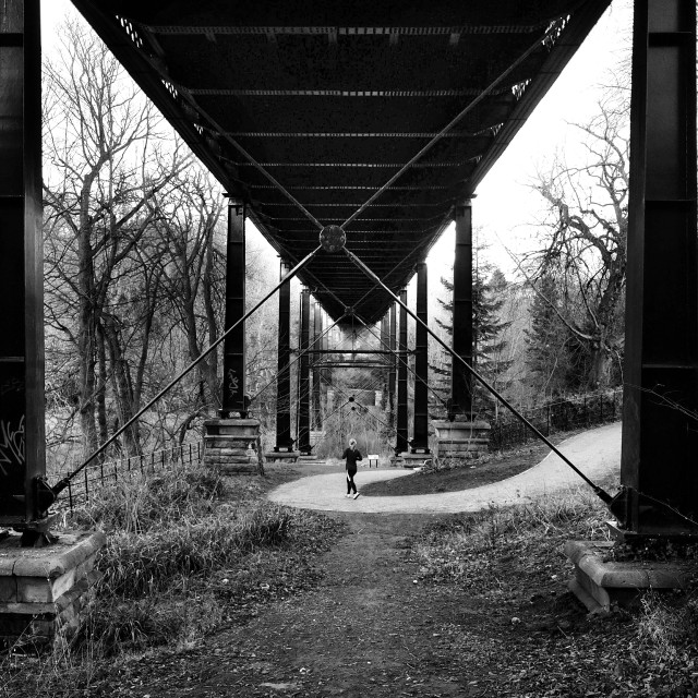 """Jogger under Armstrong Bridge, Newcastle"" stock image"