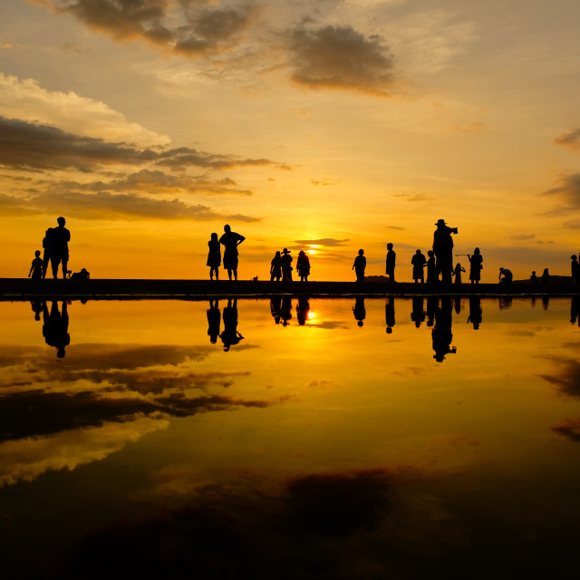 """People enjoy the sunset view o a beach"" stock image"