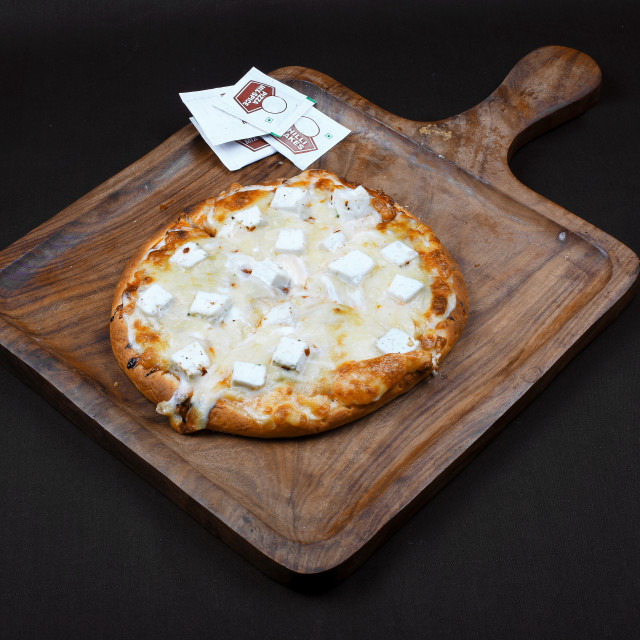 """Vegetable Paneer Pizza or Vegetable home made cheese Pizza"" stock image"