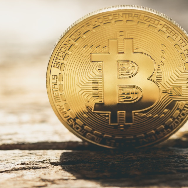 """Bitcoin on old wooden tabletop"" stock image"