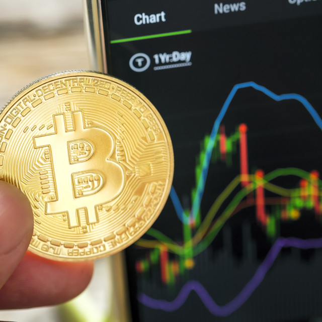 """Hand Holding Bitcoin With Graph Chart"" stock image"