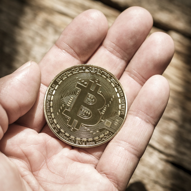 """Bitcoin on open hand"" stock image"