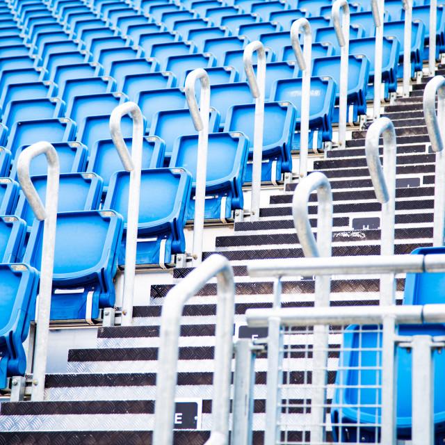 """Rows of blue plastic stadium seats."" stock image"