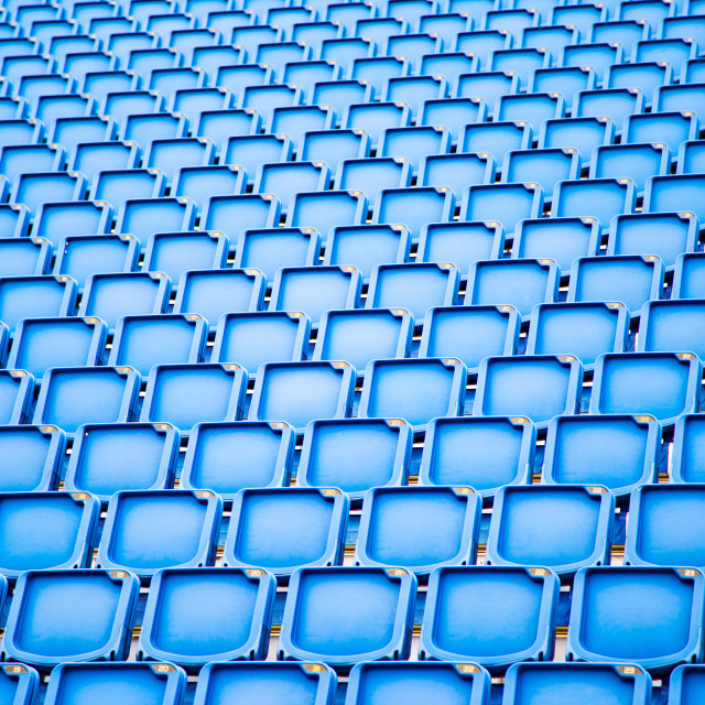 """Rows of blue plastic stadium seats."" stock image"