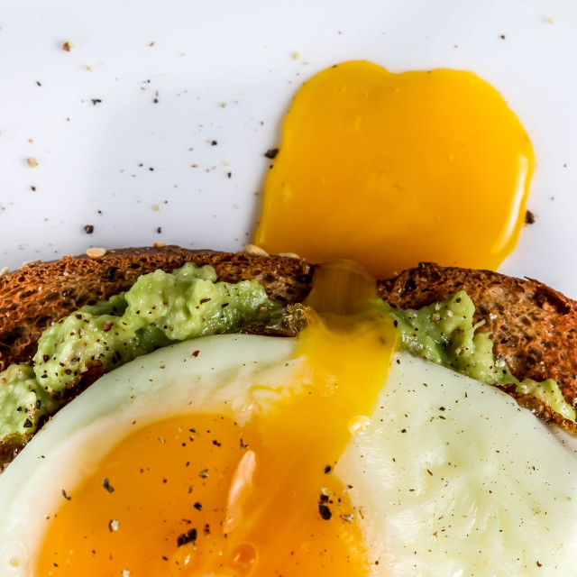 """""""Toast with avocado and egg on white plate"""" stock image"""
