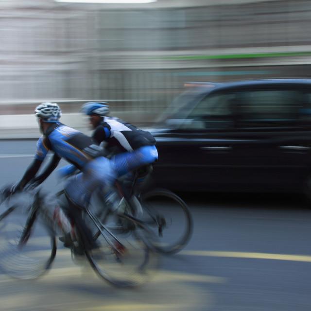 """""""Blurry bike riders"""" stock image"""