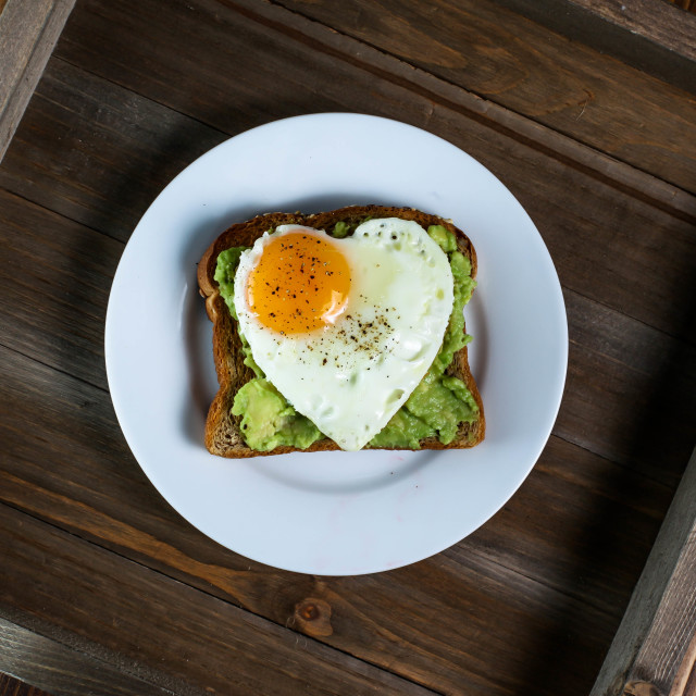 """""""Toast with avocado and egg with heart shape"""" stock image"""