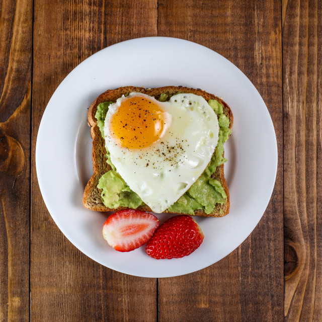 """""""Toast with avocado and egg in heart shape"""" stock image"""