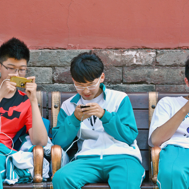 """Boys And Their iPhones"" stock image"