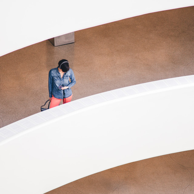 """Woman walking in a museum"" stock image"