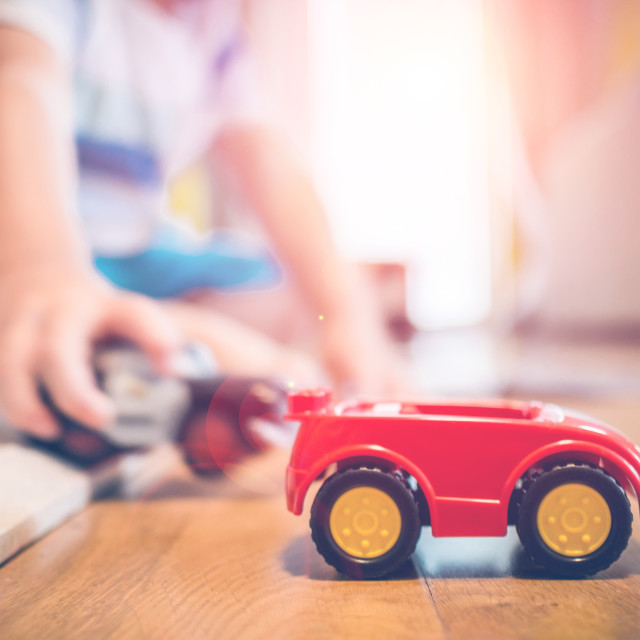 """two years old boy is playing with his toys indoors"" stock image"
