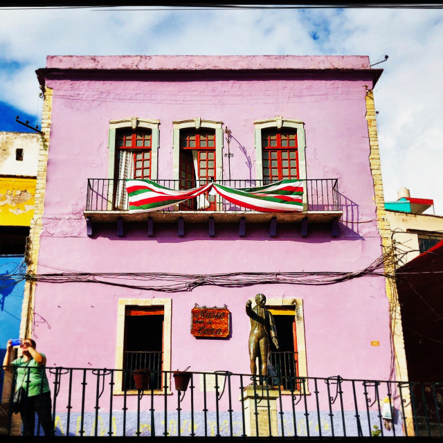 """Mexican Flags adorn Pink Building"" stock image"