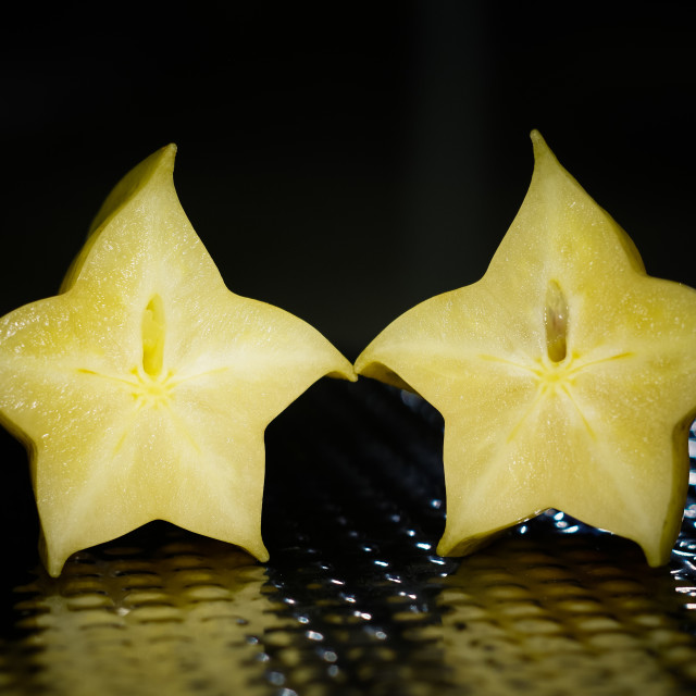 """Couple of half of star fruit"" stock image"