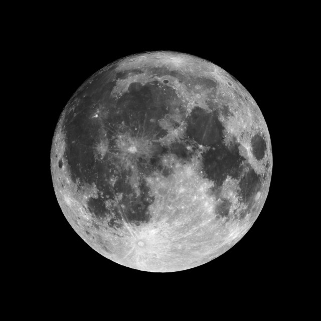 """Full moon isolated on black night sky background"" stock image"