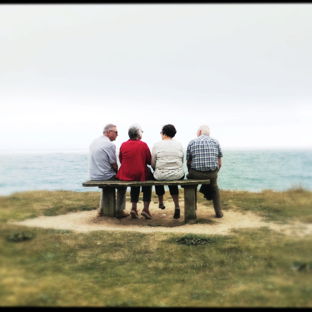 """Friends on a Bench, Jurassic Coast"" stock image"