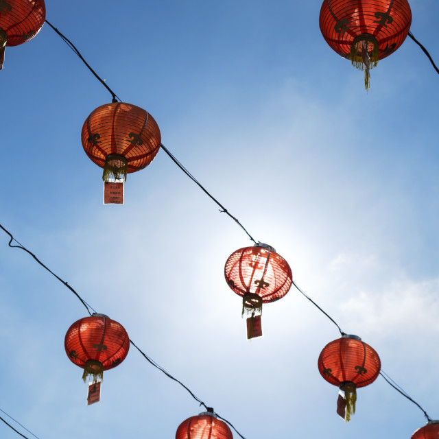 """Red Lanterns Against Blue Sky"" stock image"