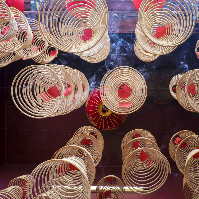 """""""Burning Spiral Incense Sticks Hanging From Ceiling"""" stock image"""