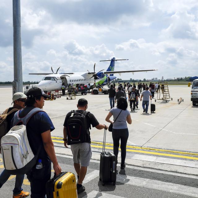 """Passengers Walk To Board Airplane"" stock image"