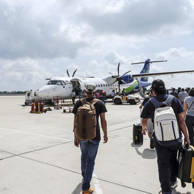 """Passengers Walking To Board Airplane"" stock image"