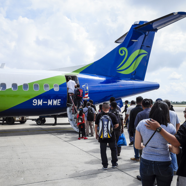 """""""Passengers Queue To Board Airplane"""" stock image"""