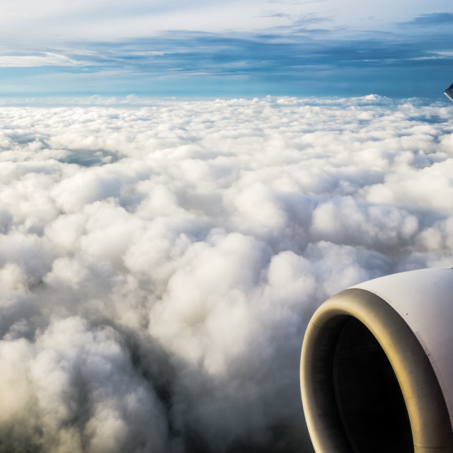"""Jet Engine And Wingtip Above Clouds"" stock image"