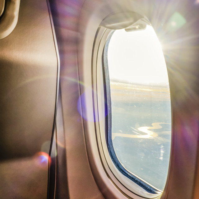 """Sun Flare Through Airplane Window"" stock image"