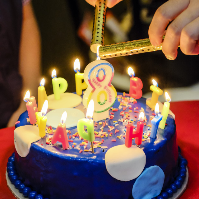 """Lighting Candles Of Birthday Cake"" stock image"