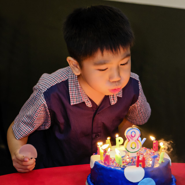"""Kid Blowing Out Birthday Candles"" stock image"